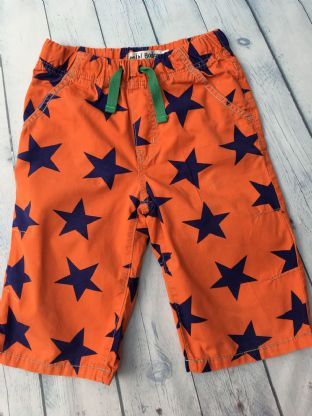 Mini Boden orange shorts with navy stars pattern age 9 (fits age 8-9)